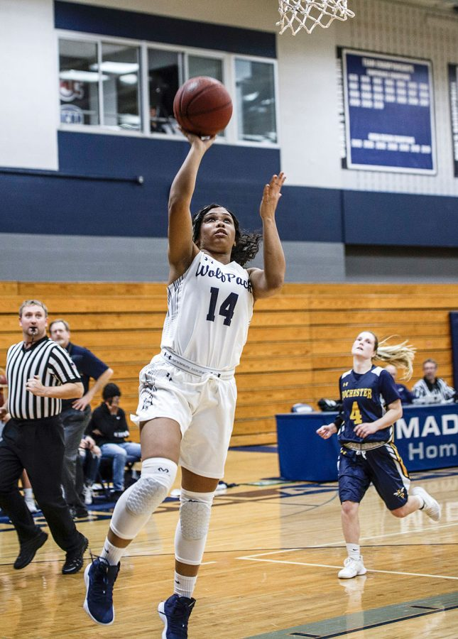 Sophomore guard Tianna Sackett drives in for a layup during the Madison College women's basketball win over Rochester Community College on Nov. 20.