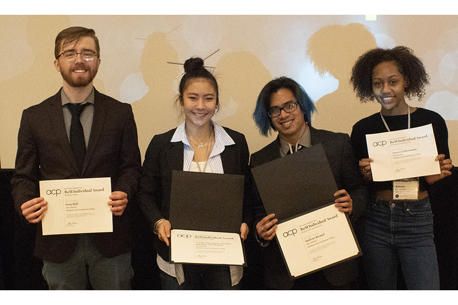 Clarion staff members, from left, Sean Bull, Tessa Morhardt, Andrew Kicmol and Amara Gobermann show awards they won