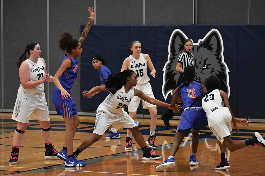 Madison College guard Shaquita Lee, 22, attempts to steal the ball from a Milwaukee Area Technical College opponent during her team's 78-49 victory at home on Feb. 16
