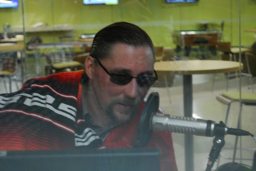 Britton Downing as Robero Domingo for his Spanish show, fills the airwaves of Clarion Radio