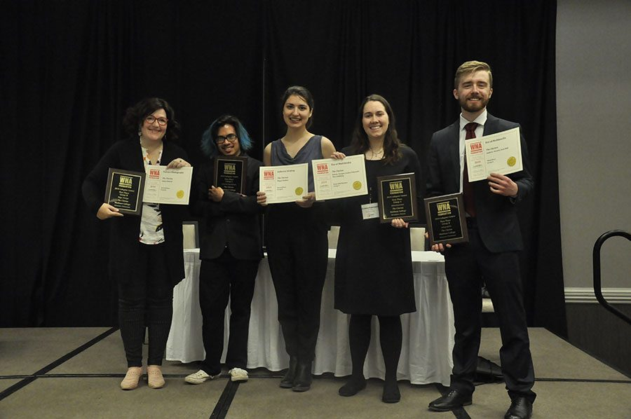 Current and former members of The Clarion display the awards they received at the WNA's annual convention on March 8. Pictured, from left, are Emily Dimond, Andrew Kicmol, Megan Binkley, Jessica Pokrandt and Sean Bull.