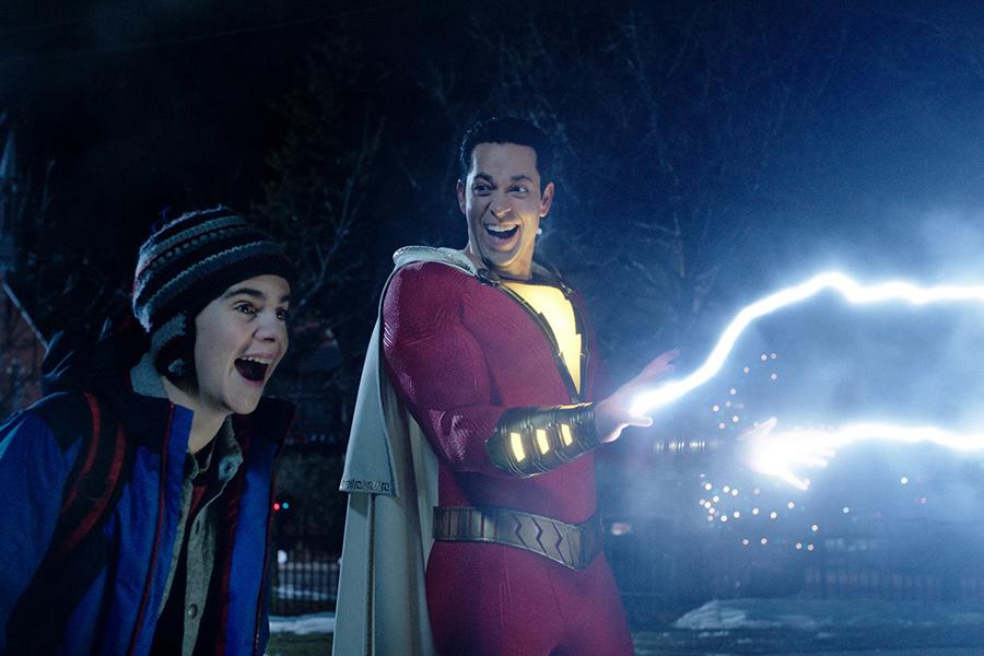 Freddy Freeman (Jack Dylan Grazer) watches Shazam (Zachary Levi) do his