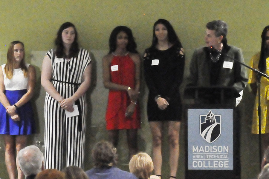 Madison College women's basketball coach Lois Heeren introduces her team during the annual athletic banquet on April 24.