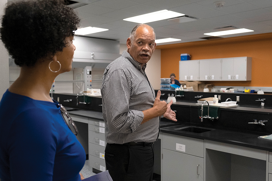 Madison College President Dr. Jack Daniels shows guests a science lab at the new Goodman South Campus on Aug. 23.