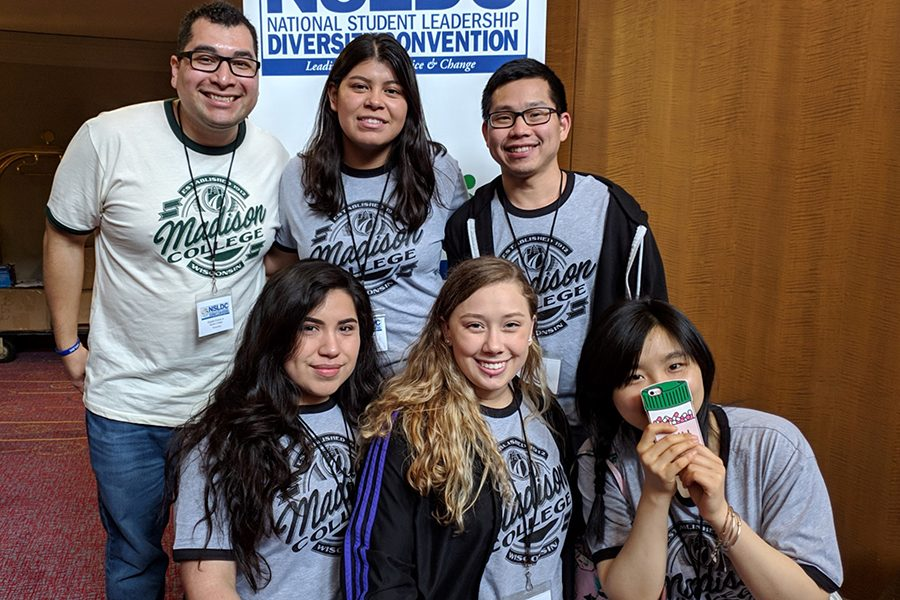 Deyshia Kinsey, front row, center, joins members of the United Common Ground for a photo at a conference last spring. Kinsey enters her second year as president of the student organization.