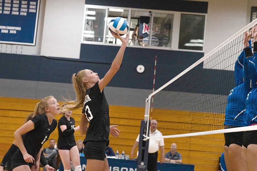 Madison College middle blocker Sidni Walgurski (13) attempts to place a shot past a pair of blockers during her teams match against Elgin Community College on Aug. 23.