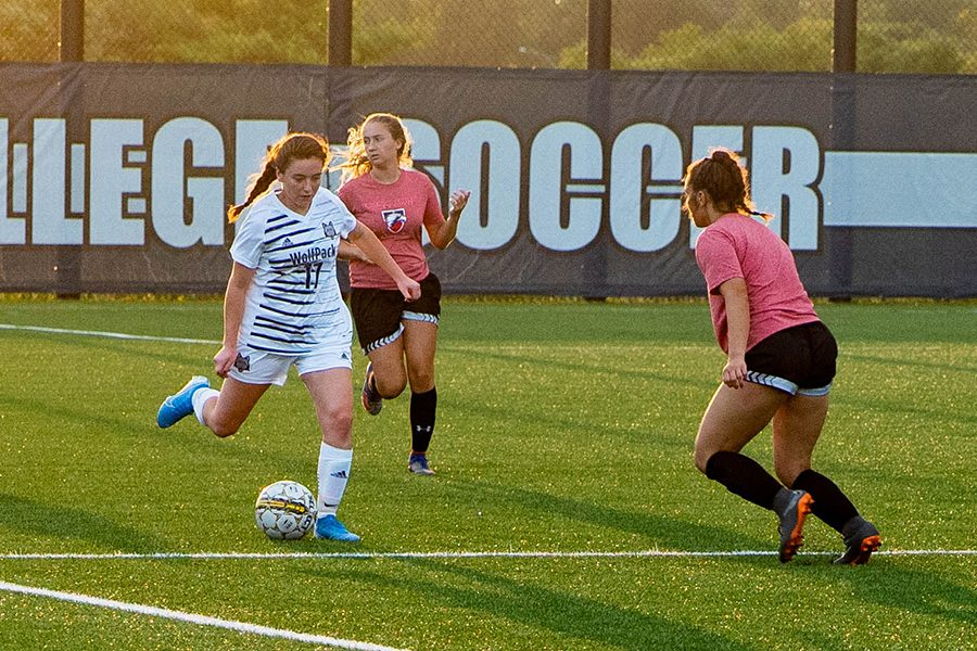 Madison College midfielder Lydia Webster (17) moves the ball past a pair of defenders during her team's scrimmage against Edgewood on Aug. 22.