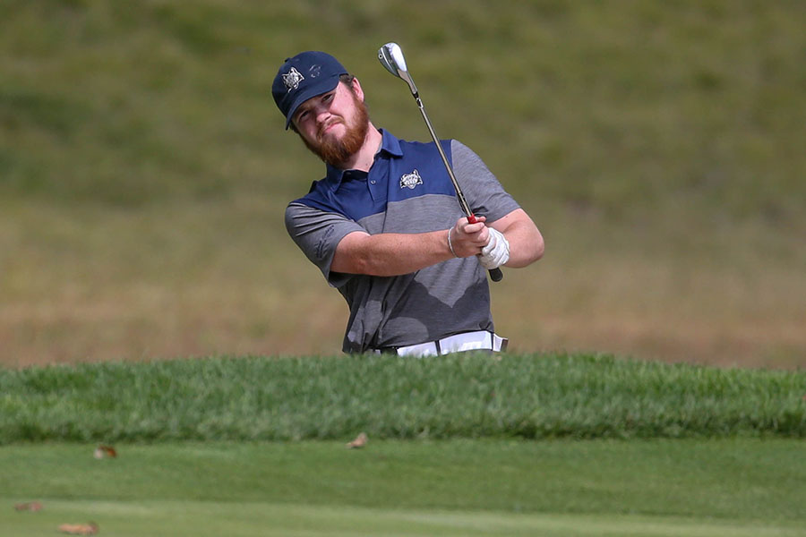 Madison College golfer AJ Gray chips the ball toward the green during a recent match at the Texas Roadhouse Madison College Invitational on Sept. 7.