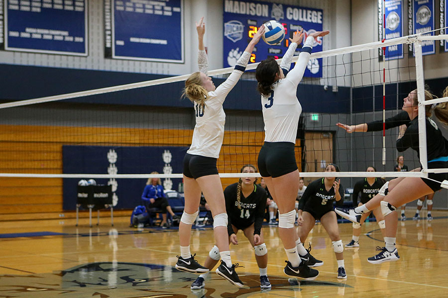 Madison College's Calla Borchert (10) and Isabella Carrillo team up to block an opponent during a recent home match.