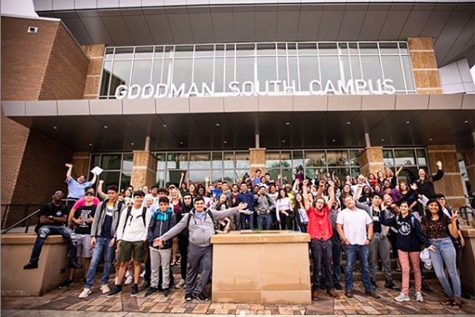Students and staff gather outside the new Goodman South Campus for a photograph on the first day of classes.
