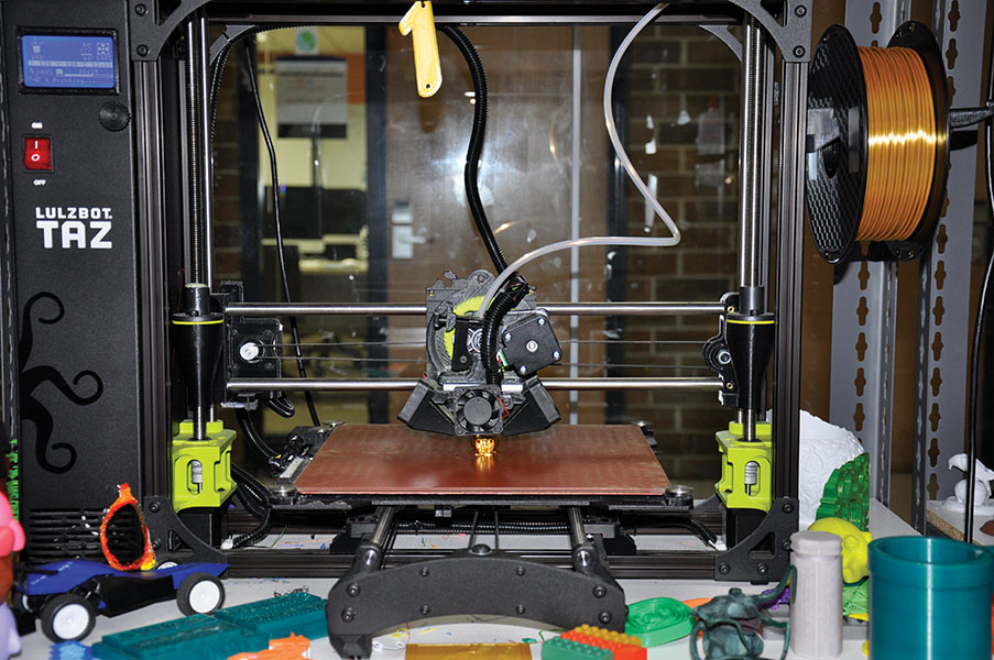 "One of the 3D printers int he STEM Center prints a pumpkin. Students can earn their Digital 3D Printing badge at two upcoming sessions planned in the STEM Center. Those sessions are on Oct. 31, from 2 p.m. to 4:30 p.m. and on Nov. 8 form 9:30 a.m. to 12:30 p.m. To participate, students must sign up ahead of time using  Eventbrite.com. Just search for ""Earn a Digital 3D Printing Badge"" by Madison College."
