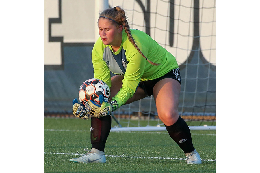 Madison College goalie Kelly Kubrick makes a save during a recent match. Kubrick has tied a school record with 12 career shutouts.
