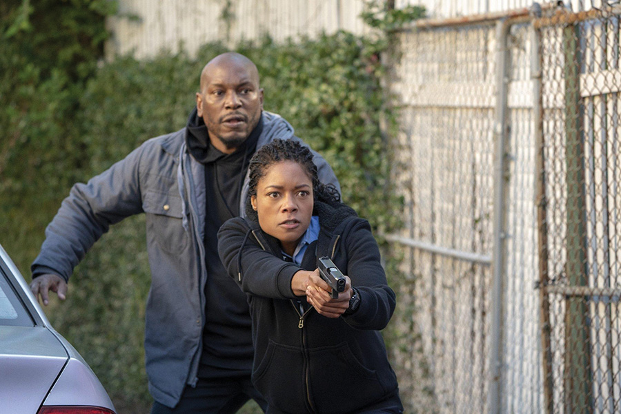 Alicia (Naomie Harris) and Milo (Tyrese Gibson) in