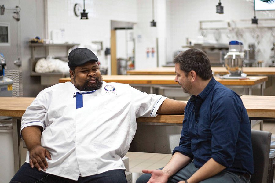 Chef Michael Twitty visists with host Kyle Cherek during the Chef Series event on Oct. 23.