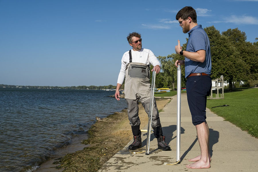 Britton Downing, left, meets with Luke Wynn of the Nearshore Water Quality Monitoring program at James Madison Park.