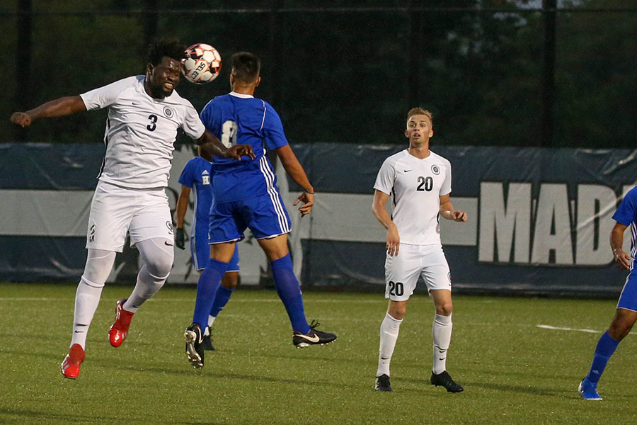 Madison College men's soccer player Muhammed Sallah (3) heads the ball away from an opponent during a recent match at Goodman Pitch East.