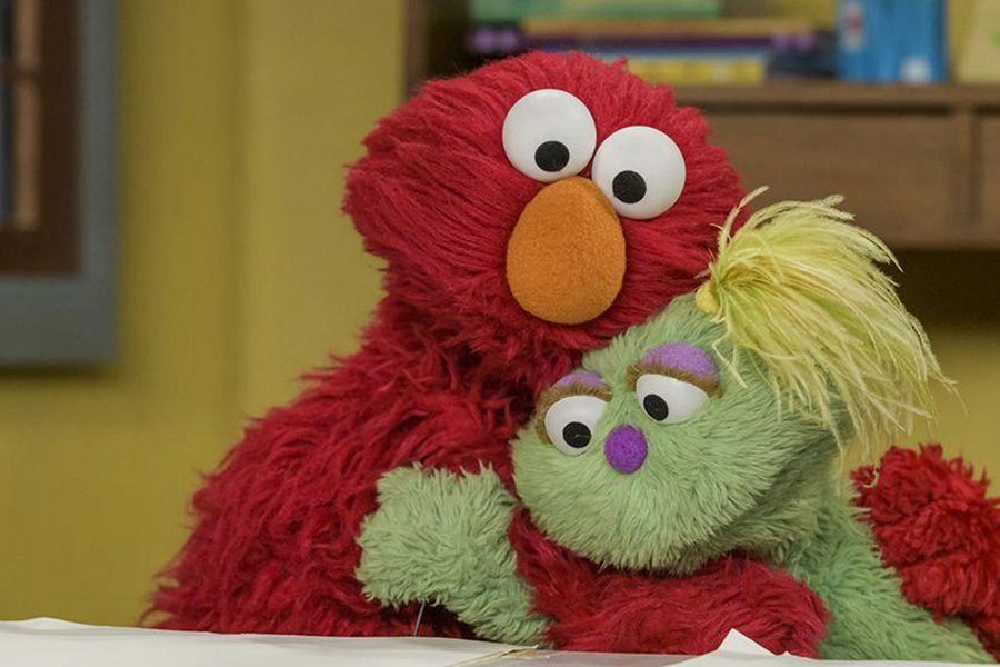 """Elmo and Karli on """"Sesame Street."""" In May, the show's creators introduced Karli, a Muppet in foster care, and in October they revealed the reason for her situation: Her mom struggles with substance abuse."""