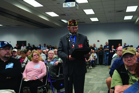 A community member speaks at the Alliant Energy Center during a National Guard Bureau meeting to discuss the environmental impact of bringing two squadrons of F-35A aircraft to the Dane County Regional Airport.