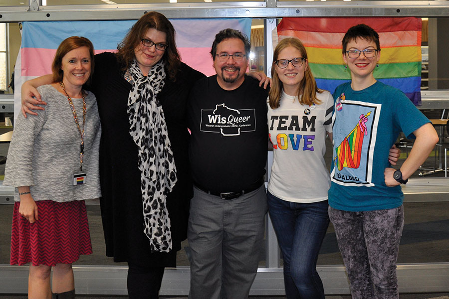 Professor Claire Lind, Co-advisor Emmalee Pearson, Co-advisor Victor Raymond, GSA officer Tierney Miller, and GSA officer Pete Beach gather for a photo after the club's National Coming Out Day celebration at the Truax Campus on Oct. 11.