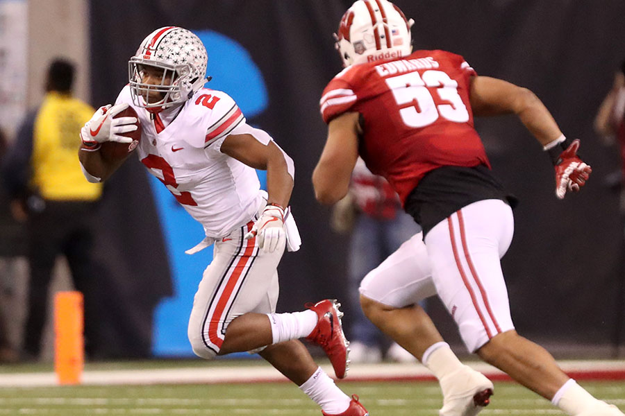 Ohio+State+Buckeyes+running+back+J.K.+Dobbins+%282%29+looks+for+yards+against+Wisconsin+Badgers+linebacker+T.J.+Edwards+%2853%29+in+the+second+quarter%2C+Saturday%2C+December+2%2C+2017.