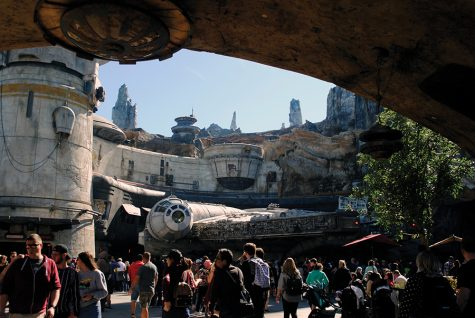 The Millennium Falcon sits parked outside the outpost, which houses the Smuggler's Run ride inside Star Wars: Galaxy's Edge at Walt Disney World in Orlando, Florida.