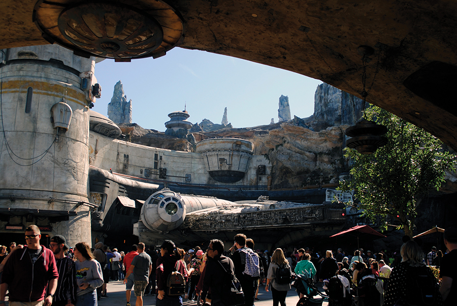 The+Millennium+Falcon+sits+parked+outside+the+outpost%2C+which+houses+the+Smuggler%E2%80%99s+Run+ride+inside+Star+Wars%3A+Galaxy%E2%80%99s+Edge+at+Walt+Disney+World+in+Orlando%2C+Florida.