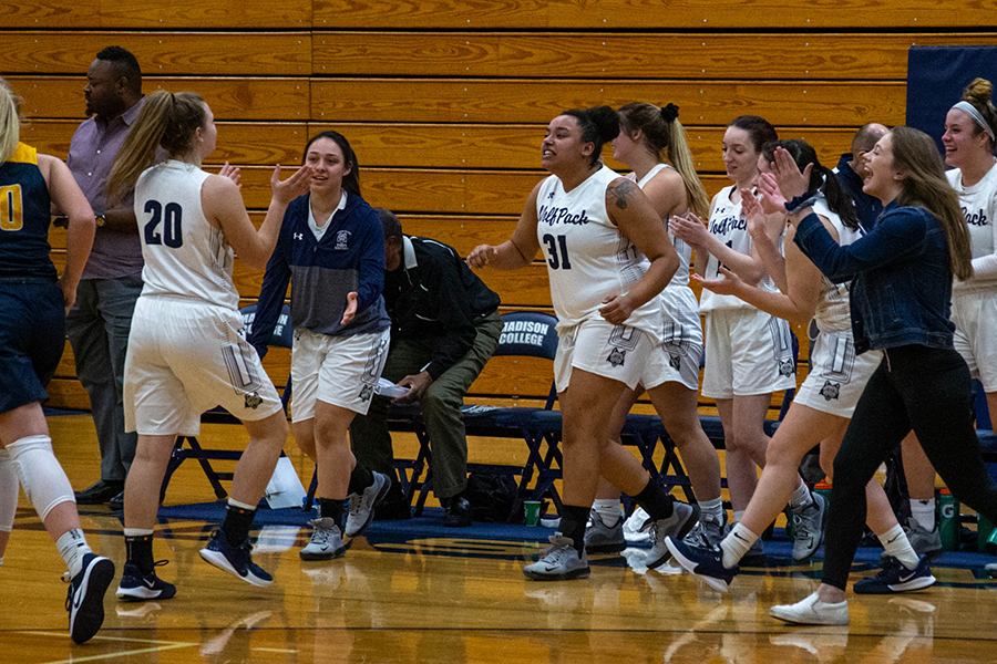 Madison College's Amber Sue Udelhoven his greeted by her teammates after hitting a basket against Rock Valley College on Jan. 4.