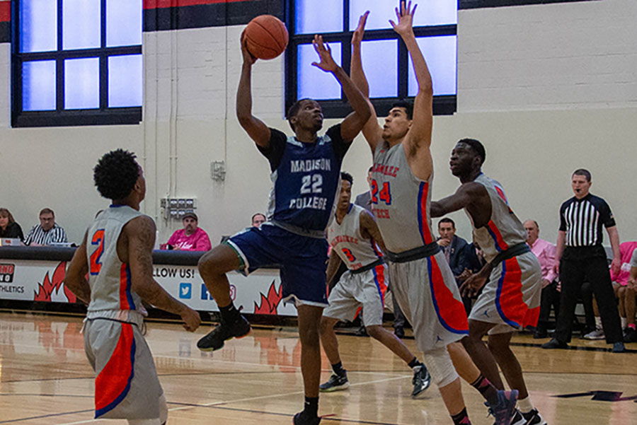 Madison+College%27s+Shamar+Newman+goes+up+for+a+shot+against+Milwaukee+Area+Technical+College+on+Feb.+15.