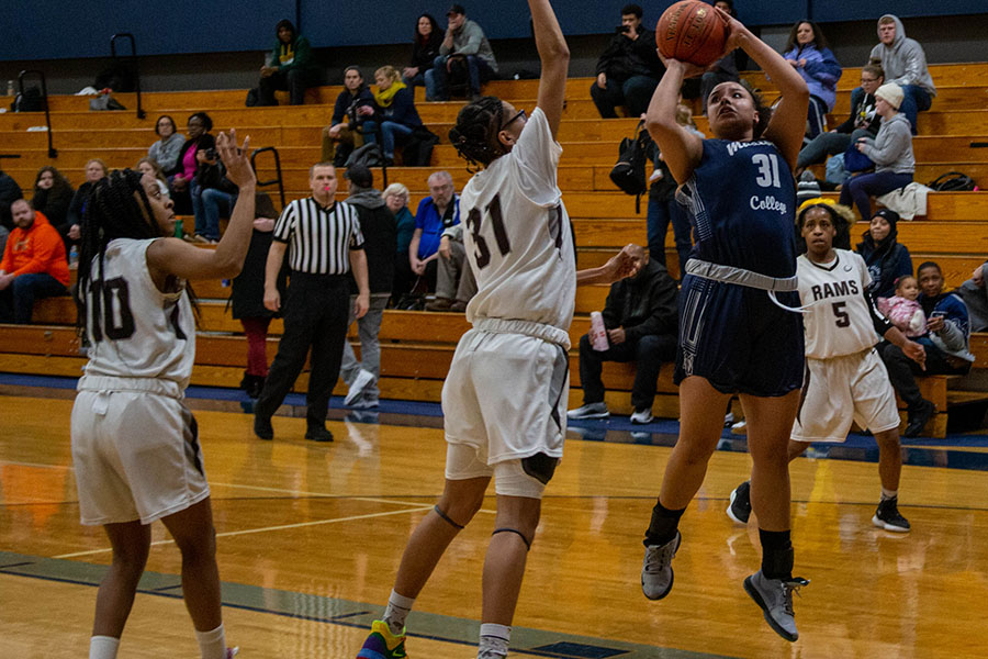 Madison College's Lilly Dorman puts up a shot against Wilbur Wright College.