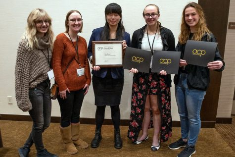 Members of The Clarion staff show awards the paper received at the Best of the Midwest College Journalism Conference. Pictured, from left, are: Britni Petitt, Mandy Scheuer, Maia Lathrop, Christina Gordon and Anica Graney.