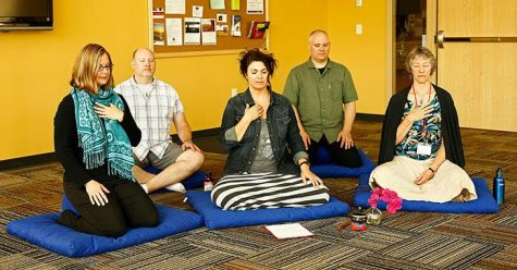 An Experiencing Mindfulness and Stress Reduction session held in 2015 is led by Amy Nicolson, center.
