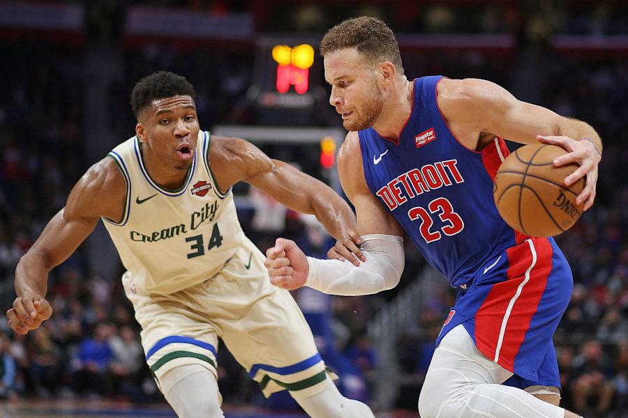 Detroit Pistons forward Blake Griffin (23) drives against Milwaukee Bucks forward Giannis Antetokounmpo (34) in their NBA game at Little Caesars Arena in Detroit, on Dec. 4, 2019. The Bucks won the game, 127-103.