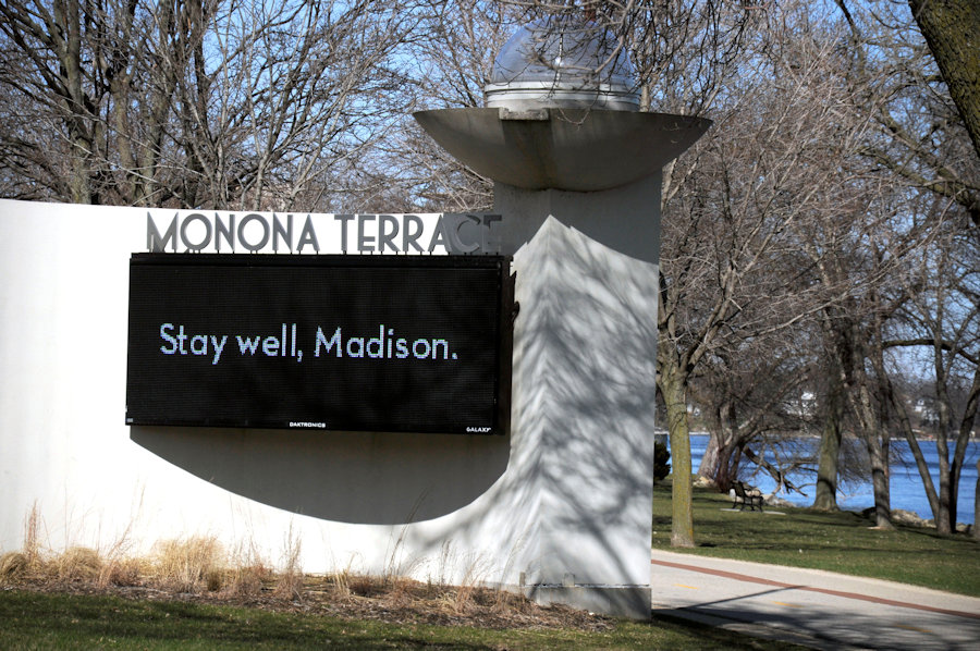 A sign on Monona Terrace offers encouragement to drivers and pedestrians to stay healthy