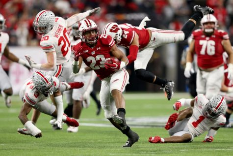 Jonathan Taylor #23 of the Wisconsin Badgers runs for a touchdown in the Big Ten Championship game against the Ohio State Buckeyes at Lucas Oil Stadium on Dec. 7, 2019, in Indianapolis, Ind.