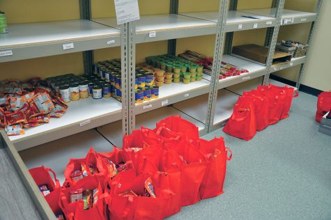 The red bags hold up to 10 lbs of food for students available at the college's drive-up food pantry sites.