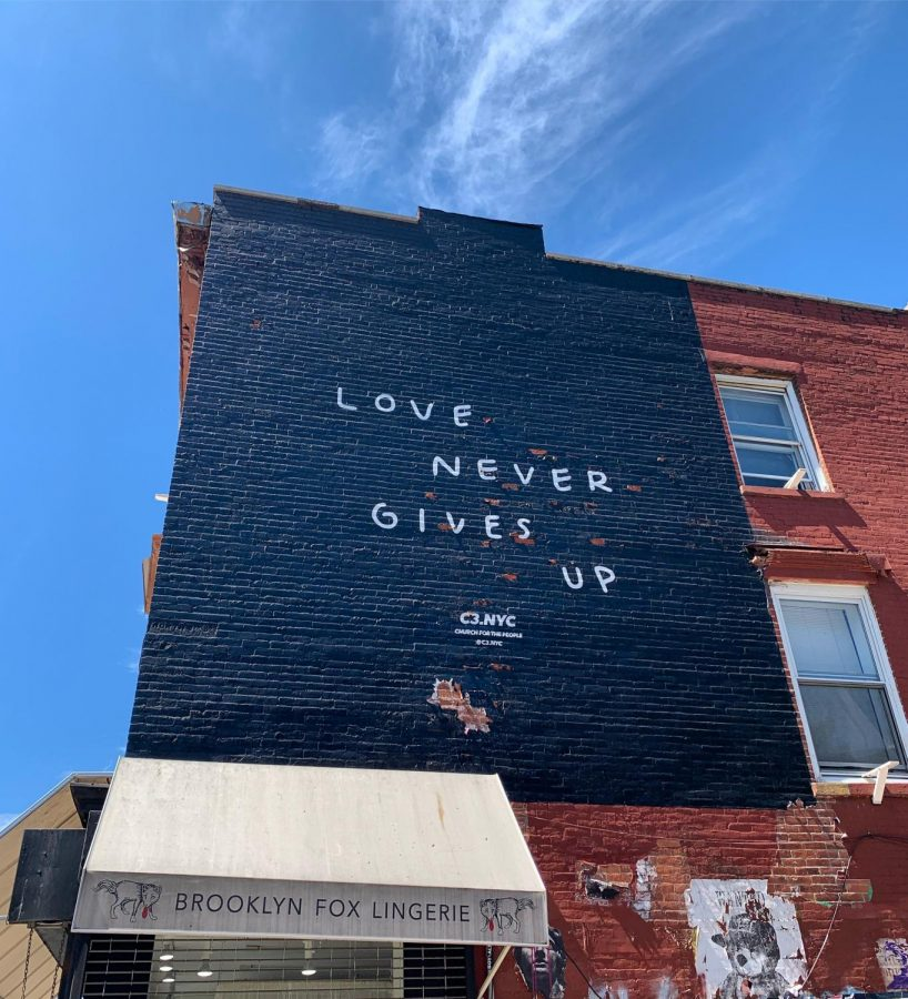 A mural on a wall in Brooklyn, N.Y., reminds people of the importance of love.