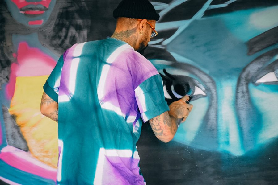 Madison artist Tony Catteruccia works on an equity mural for the Yahara Journal on Sept. 25.