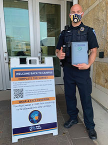 Officer Nic Tatro with a completed health survey.
