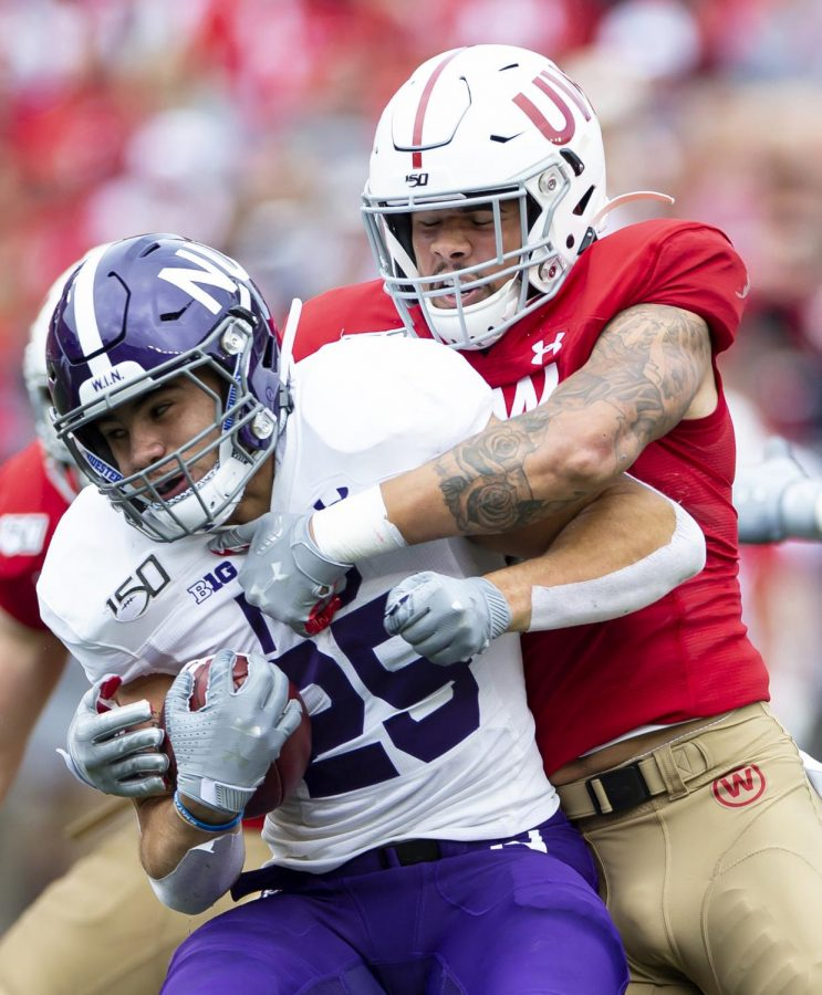 While former Wisconsin Badgers linebacker Zack Baun, right, will be playing this fall in the NFL, his old teammate will be sidelined. The Big Ten and Pac-12 have postponed all fall sports due to the pandemic and hope to play their seasons in the spring. The NCAA still plans to hold a College Football Playoff at the end of the fall season, leaving the Badgers out.
