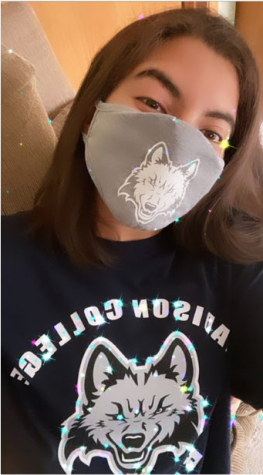"Student participates in ""Mask Monday"" by sharing a selfie on social media wearing a mask."