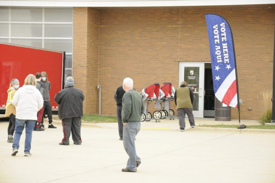 Voters file in to vote on the first day of early voting at the Madison College Protective Services Building at the Truax Campus.