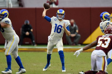 Jared Goff (16) of the Los Angeles Rams throws a pass against the Washington Football Team at FedExField on Oct. 11.