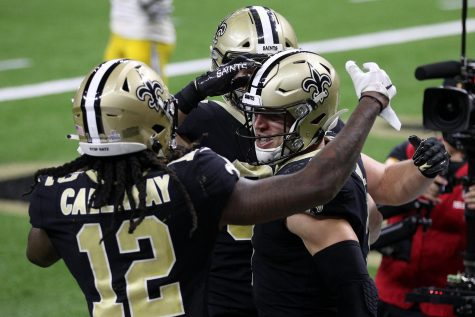 Taysom Hill (7) of the New Orleans Saints celebrates a touchdown against the Los Angeles Chargers with Marquez Callaway (12) on Oct. 12 in New Orleans.