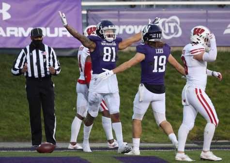 Northwestern wide receiver Ramaud Chiaokhiao-Bowman (81) celebrates after making a touchdown reception against Wisconsin in the second quarter on Nov. 21.