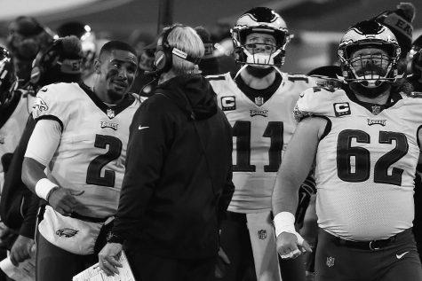 Eagles quarterback Jalen Hurts (2) talks with Eagles head coach Doug Pederson on Dec. 6, at Lambeau Field in Green Bay.