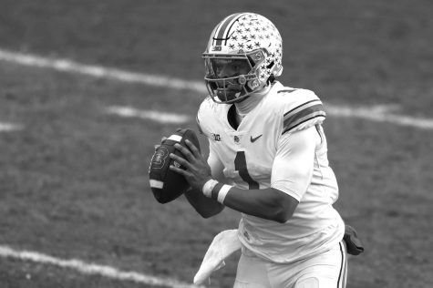 Ohio State quarterback Justin Fields looks to pass in the second half against Michigan State at Spartan Stadium in East Lansing, Michigan, on Saturday, Dec. 5, 2020. Ohio State won, 52-12.