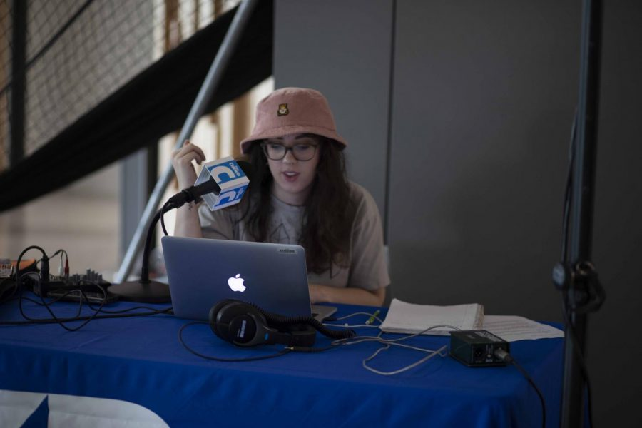 Cassandra Cullen is Clarion Radio's new General Manager, pictured at a radio booth at one of the campus club events.
