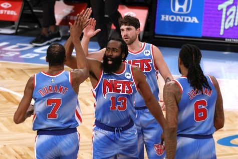 The Brooklyn Nets' Kevin Durant (7), James Harden (13), Joe Harris (12), and DeAndre Jordan (6) high-five during the first half against the Orlando Magic at Barclays Center in New York on Jan. 16.