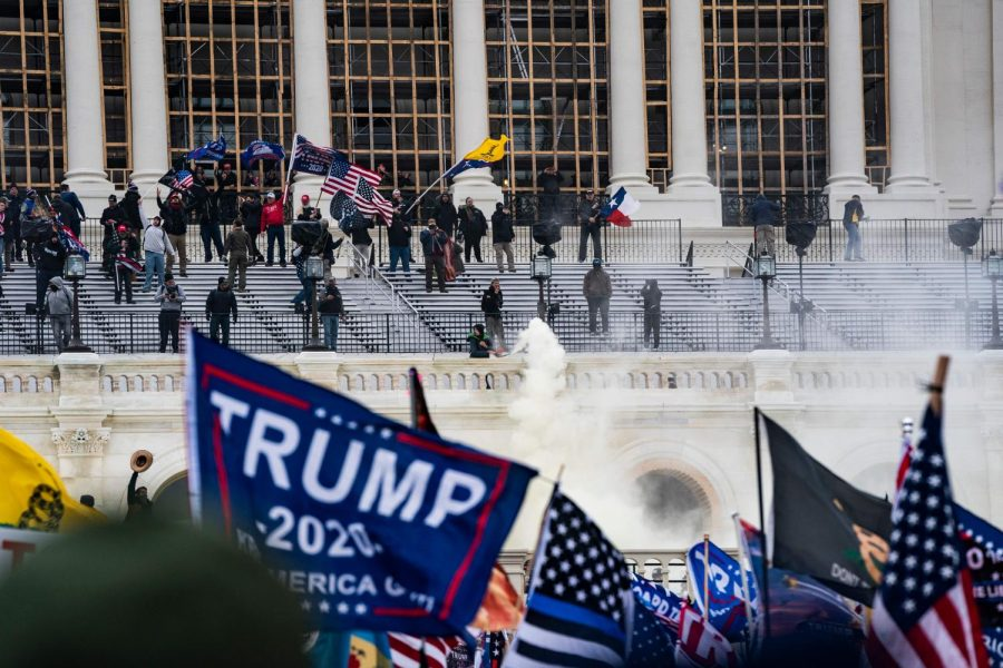 A pro-Trump mob enters the U.S. Capitol Building on Wednesday, Jan. 6, 2021, in Washington, D.C. A Florida grocery chain heiress donated $300,000 to support a Trump rally before the riots took place.
