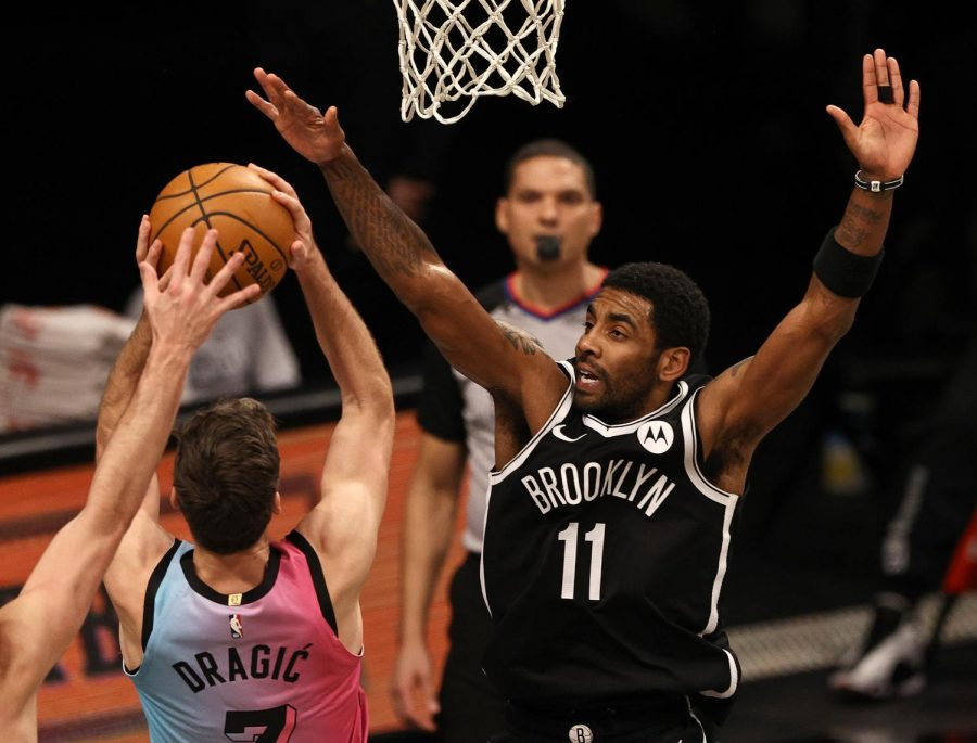 The Miami Heat's Goran Dragic heads for the net as the Brooklyn Nets' Kyrie Irving (11) defends in the second half at Barclays Center in New York on Jan. 23. The Nets won, 128-124.